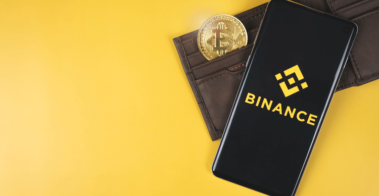 The Binance mobile app and a wallet with a Bitcoin