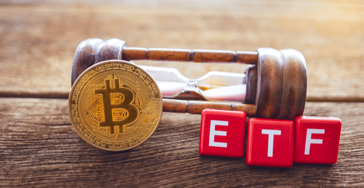 Image of a Bitcoin with an hourglass and the letters of ETF