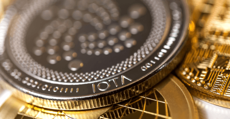 The IOTA coin in front of other cryptocurrencies
